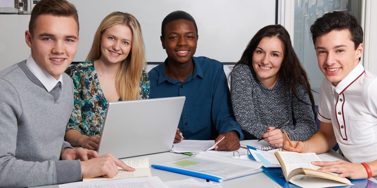 Group Of Teenage Students Working In Classroom